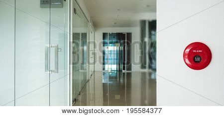 Fire alarm, emergency button on white wall in modern interior