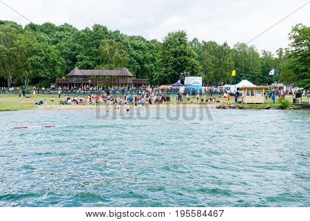 LAKE WERBELLINSEE GERMANY - JUNE 25 2017: Public beach. View from the side of the lake. Werbellinsee is a lake in the Barnim district of Brandenburg. During the GDR the largest Young Pioneer camp was located.