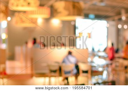 Blurred restaurant (cafe) interior with some people -can be used as background