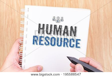 Human Resource Word On White Ring Binder Notebook With Hand Holding Pencil On Wood Table,business Co