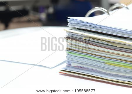 Pile of papers and documents on white table at workplace,office supplies,business concept.