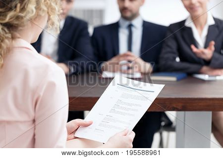 Woman holding her resume during job interview