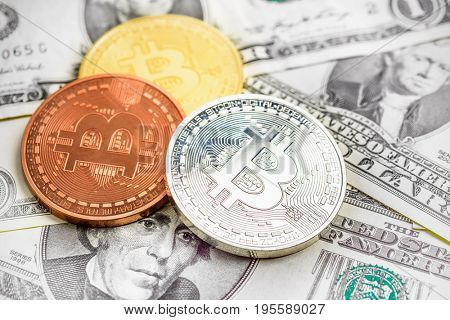 Bitcoin coins over money background
