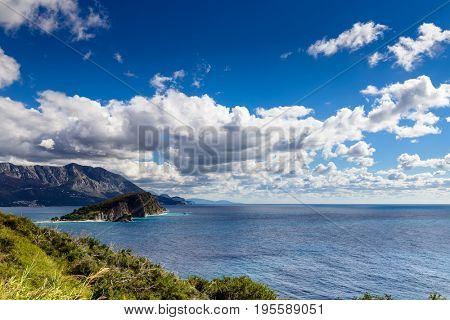 Panoramic landscape of Budva riviera in Montenegro. Fantastic view of the overcast sky. Dramatic morning scene. Balkans, Adriatic sea, Europe