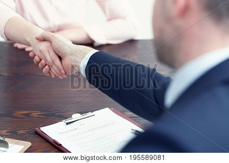 Woman getting a job after successful interview