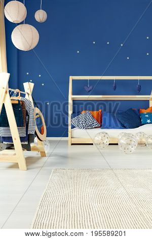 Room With Bed And Coat Rack