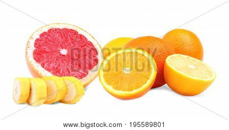 Various colorful summer fruits isolated over the white background. Tasteful scarlet grapefruit cut in half. Little nutritious slices of a banana. Juicy ripe raw oranges.