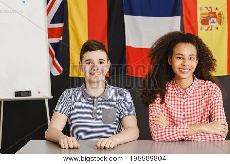 Boy learning different languages with his young teacher