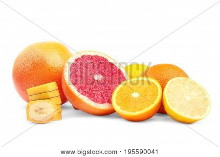 Different healthful citruses and a yellow sliced banana isolated on the white background. A group of tropical fruits: juicy grapefruit, sweet oranges and a sour lemon.