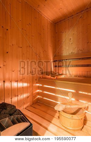 Spacious wooden sauna room in home for regeneration