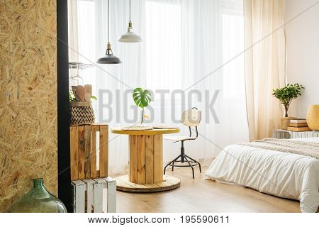 Upcycled Table From Cable Spool In Bedroom