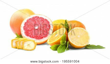 A group of fresh bright fruits and green mint leaves isolated over the white background. Red raw grapefruit, nutritious yellow lemon, sliced colorful oranges.