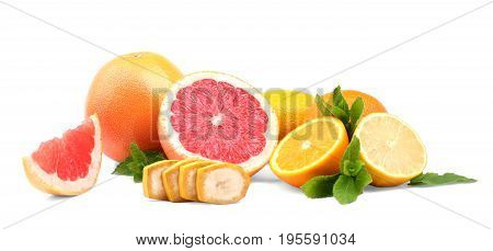 A mix of beautiful summer fruits isolated over the white background. Fresh organic citruses with a cut banana and green peppermint leaves. Health, organic, freshness concept.