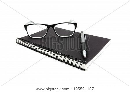 Notebook glasses and pen on white background.
