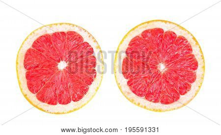 Close-up two perfect halves of a delicious grapefruit isolated over the white background. Colorful sour grapefruit chopped in half. Tasty natural summer fruits.