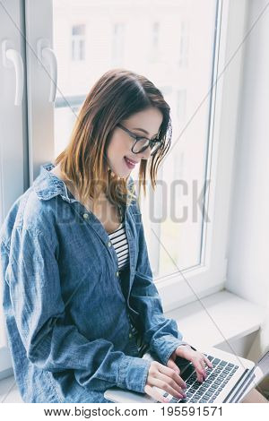 Young Self-employed Woman With Laptop