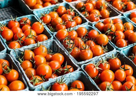 Tomatoes from farms market in paper containers