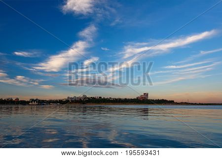 Cityview of Irkutsk with blue evening sky and clouds and their reflection in water