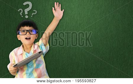 boy holding tablet raise his hand up for question asking