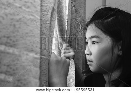 Girl Open Curtain Looking Outside With Absent Minded