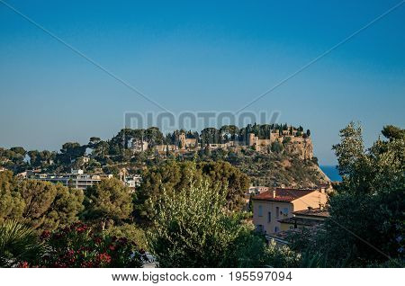 View of castle on top of a hill near the city center of Cassis, a beautiful and sunny seaside town with harbor. Located in the Bouches-du-Rhone department, Provence region, southeastern France
