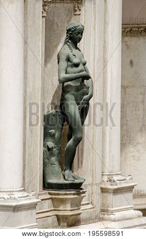 Statue of the biblical character Eve sculpted by the Renaissance artist Antonio Rizzo and on public display on an exterior wall of the Doge's Palace Venice Italy.