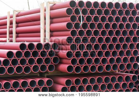 Stockyard of various tubes and pipes at a construction site.