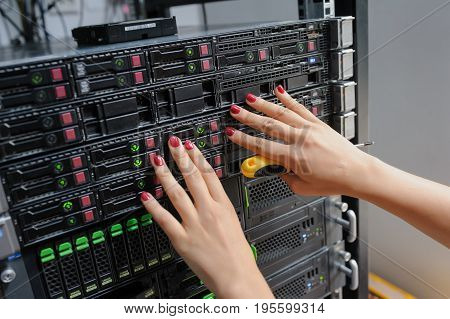 Close-up Of Young Woman Engineer It In A Server Room