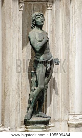 Statue of the biblical figure Adam by the Renaissance sculptor Antonio Rizzo on public display on an exterior wall of the Doge's Palace in Venice Italy.