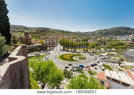 Panorama view on monument to Vakhtang I Gorgasali near Metekhi Church of the Dormition of the virgin and Europe square with round flowerbed. Famous landmark in Tbilisi Georgia. Tbilisi Georgia country.
