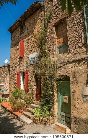 Sillans-la-Cascade, France - July 10, 2016. View of buildings in alley with sunny blue sky, at the quiet Sillans-la-Cascade, near Draguignan. Provence region, Var department, southeastern France