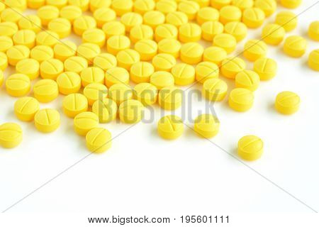 Small medicine tablets (or pills) on white background