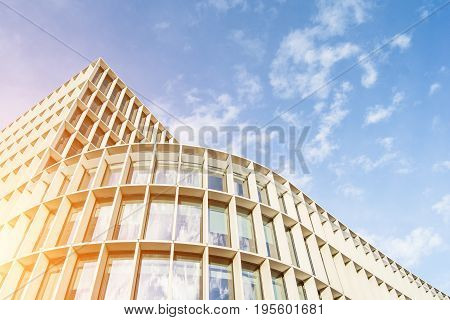 Low angle view of skyline in London city with warm sunny light. Graphic background of skyscraper with office windows. Panoramic architecture building with business and finance concept.