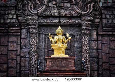 Brahma gold shabby old statue in Thailand