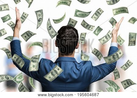 Portrait of an happy man in a rain of money