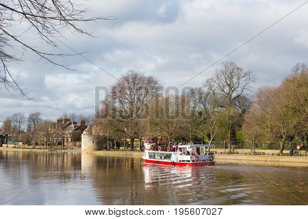 York England boat trip on the River Ouse a popular tourist attraction