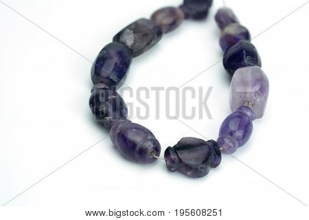 Ancient variety shapes of semiprecious Amethyst beads on white background