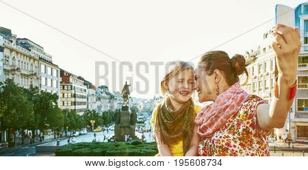Mother And Child Tourists In Prague Taking Selfie With Phone