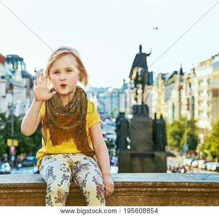 Child On Vaclavske Namesti In Prague Czech Republic Handwaving