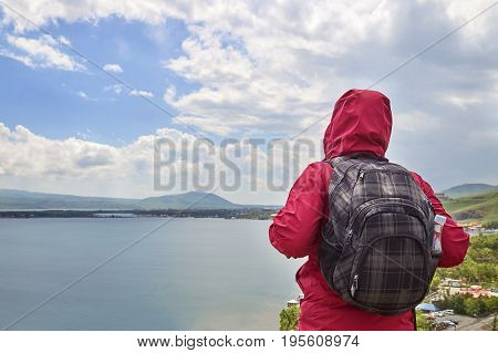 Female hiker looking at beautiful view of a mountain lake