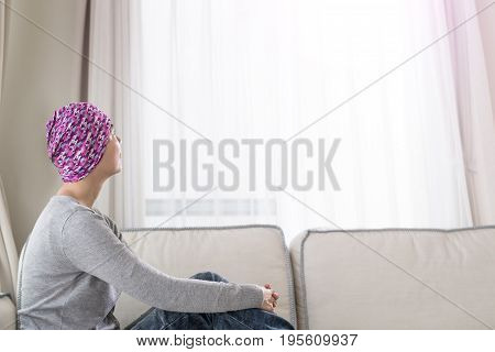 poor cancer woman look somewhere at home
