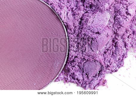 Crushed purple eye shadow  on the white background
