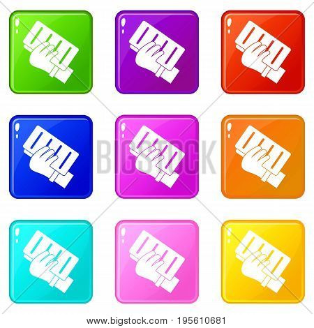 Brick in a hand icons of 9 color set isolated vector illustration