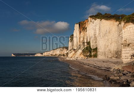 The beautiful and dramatic chalk cliff coastline of Yport with Fécamp in the distance, a commune in the Seine-Maritime department in the Normandy region of north western France