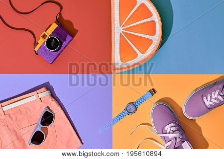 Fashion Summer Hipster Set. Film Camera, Clothes Accessories. Glamor Orange Citrus Clutch, Trendy fashion Sunglasses. Urban Outfit. Hot summer color. Creative Bright Pop Art Style. Retro Design camera