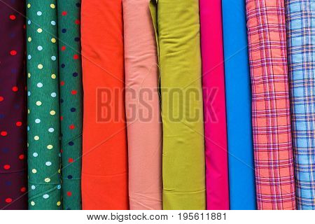 Multi color fabric in a row. Colorful fabric texture background