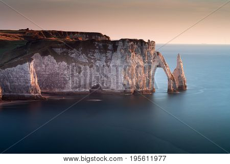 Dusk at L'Aiguille and Porte d'Aval The pointed formation called L'Aiguille or the Needle and Porte d'Aval at Etretat, a commune in the Seine-Maritime department in the Normandy region of north western France