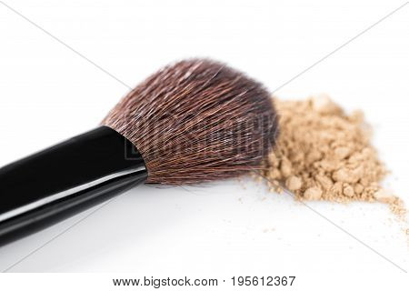 Beige powder for face and makeup brush isolated on the white background