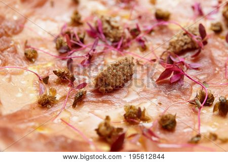 Tuna carpaccio with truffle paste and capers, Italian seafood appetizer