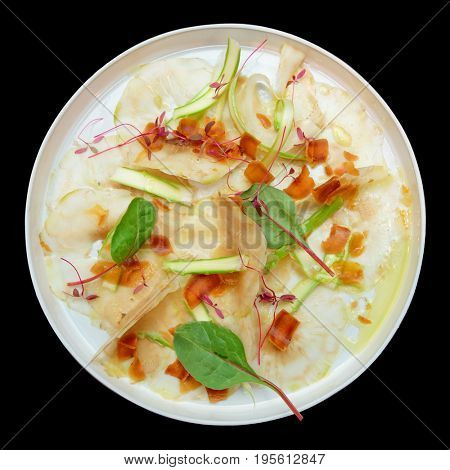 Carpaccio from artichoke and bottarga roe isolated on black background